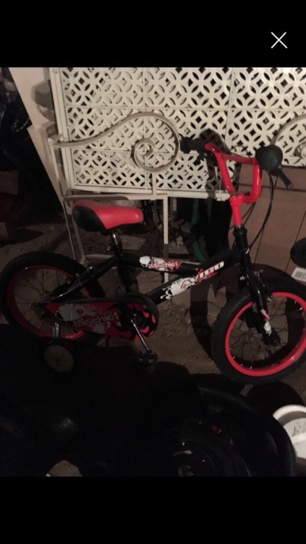 New boys bike with detachable training wheels.