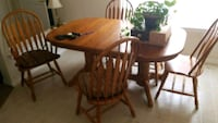 oval brown wooden table with four chairs dining set College Station, 77845