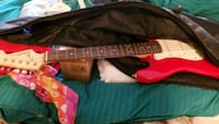 red and white electric guitar Poolesville, 20837