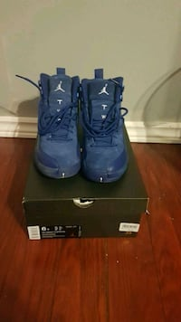 pair of blue Air Jordan basketball shoes on box