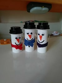 three white snowman canisters