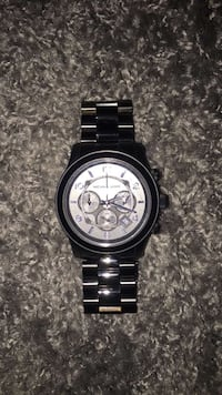 Round silver chronograph watch with silver link bracelet North Fort Myers, 33903