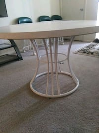 brown wooden table with gray steel base 42 km