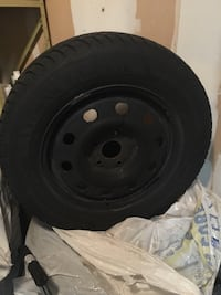 Black bullet hole vehicle wheel and tire Kitchener, N2K 4J4