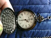 round gold-colored analog watch with black leather strap Newark