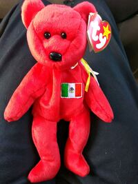 red and yellow TY Beanie Baby bear plush toy Reno