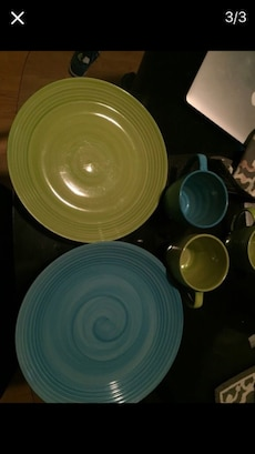 Blue and green ceramic mugs and plates