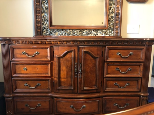 5 piece bedroom set including king size mattress. Real cherry wood. Good condition. Selling due to moving