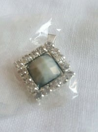 silver-colored pendant with black gemstone Laval, H7W 2Z9