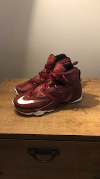 maroon-and-white Nike basketball shoes