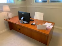 Brown wooden desk with rolling chair