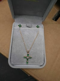 gold-colored rope chain necklace with Emerald cross pendant