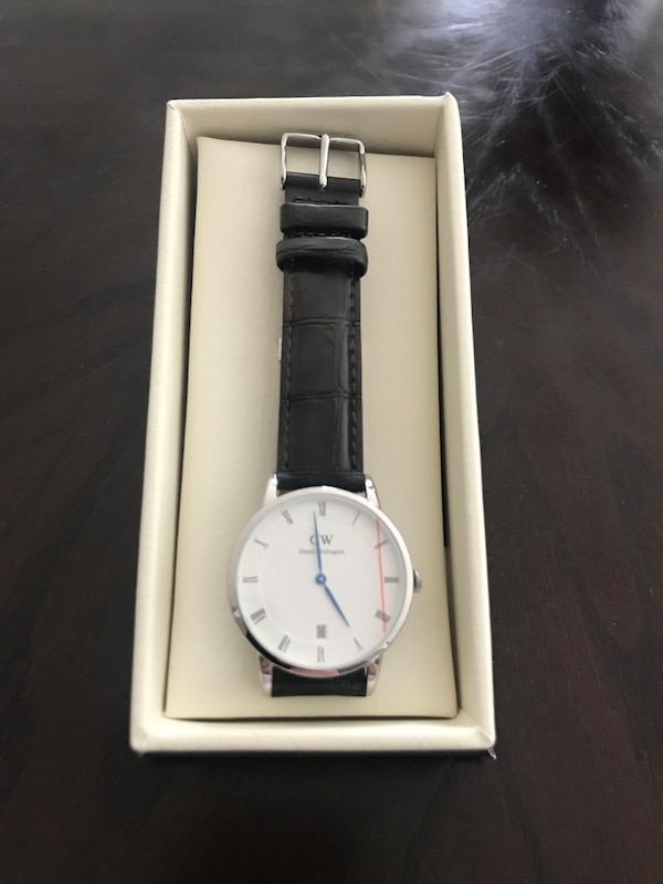 Daniel Wellington analog watch with brown leather strap