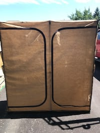 Double wardrobe- double zippers and show storage on two sides- slight tear on one side Barrie, L4M 6W5