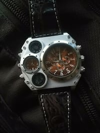 round silver chronograph watch with black leather strap Edmonton, T6H