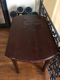 Dark wood table with fold out arms as is