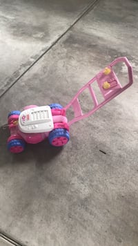 Pink and white ride on toy car