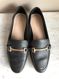 Pair of black leather loafers Toronto, M5V 3A6