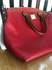 *100% Authentic Dooney & Bourke* Red Pebble Leather Ladies Handbag*  RARE Size/Design (see dimensions below)  Red Pebble Leather with smooth tan leather outline/underlayer/handles/removable strap  Absolutely pristine condition inside and out ** LIKE NEW * Laurel, 20707