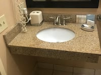 white ceramic sink with faucet and counter null