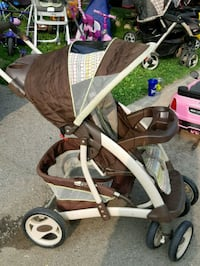 baby's brown and white stroller Hamilton, L8W 1T8