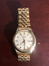 round silver-colored Seiko analog watch with link bracelet
