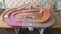 gray, orange, and purple plastic race track toy