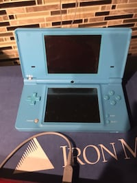 white Nintendo DS with game cartridge