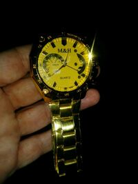 Gold color watch Inwood