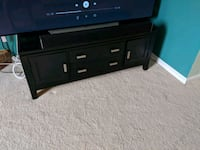 black wooden TV stand with flat screen television Arlington, 22204