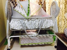 Baby's white and gray bassinet