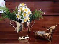 Gold vase with white and yellow plastic flowers Falls Church