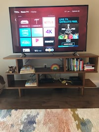 black flat screen TV with black wooden TV stand Dallas, 75205