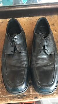 pair of black leather lace-up dress shoes