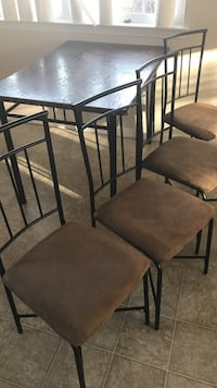 Table and 4 chairs -