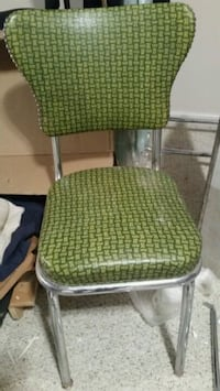 green and gray padded armchair St. Louis, 63118