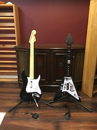 Rock band and guitar hero guitars and stands