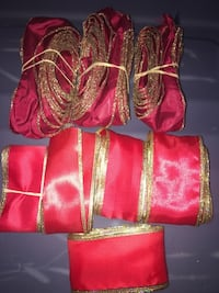 8 EUC Red Christmas Decorative Ribbons.   Can be used as garland on the tree or wreath and much more.   SF/PF Home . Vaughan, L6A