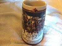 white and brown beer stein