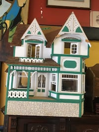 green and white plastic dollhouse