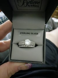 silver-colored Sterling Silver ring with box