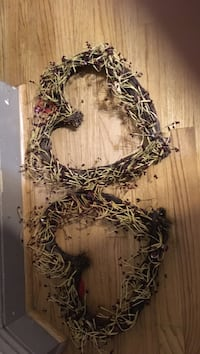 two brown heart wreaths