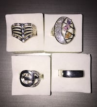Lot of four rings $30 925 stamped size 8 Calgary, T3E 6L9