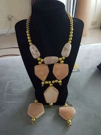 gold-colored necklace with pair of earrings Tamarac, 33321