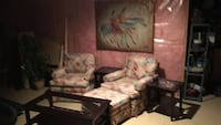 brown wooden framed brown and green floral padded armchair Calgary, T2Z 3P7