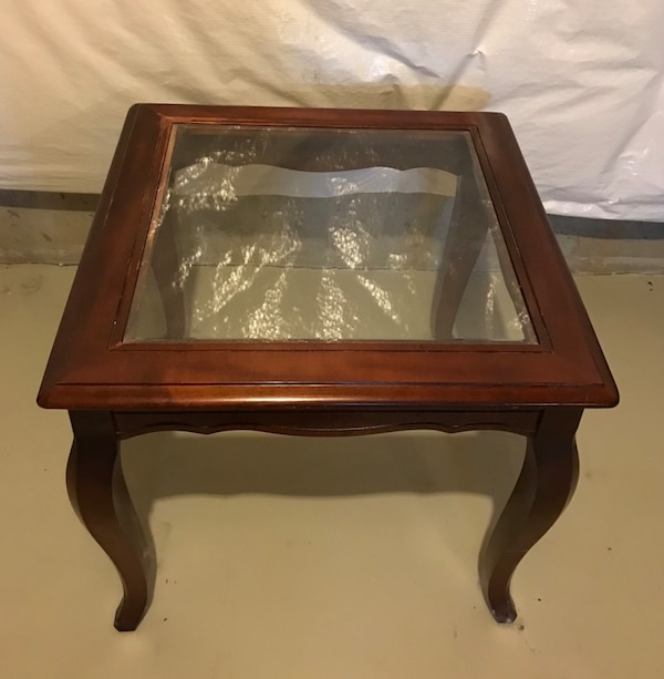 square brown wooden framed glass top side table