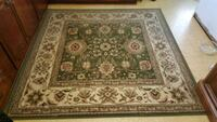 Green and white floral area rug, with deep red  Pasadena, 21122