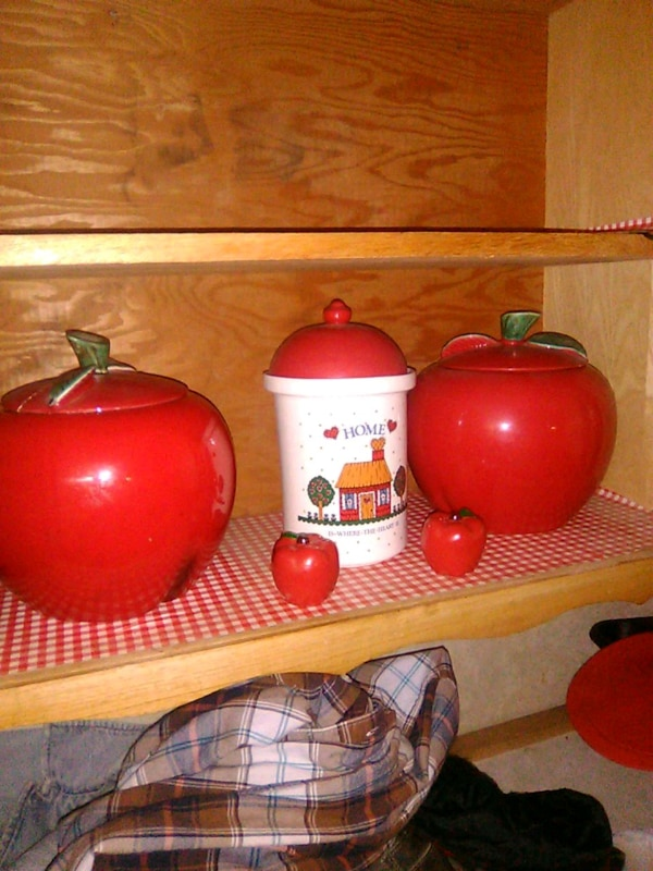 two red ceramic canisters