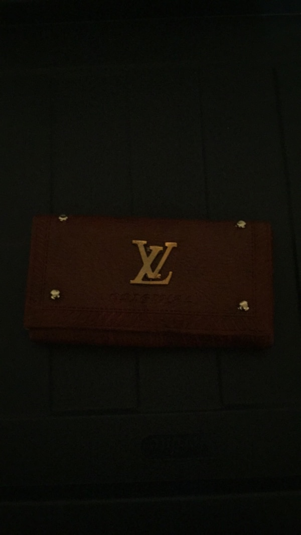 3e6db2a39022 Used red and black Louis Vuitton leather wallet for sale in San José - letgo
