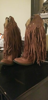 pair of brown fringe suede cowboy boots